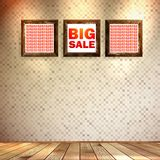 Beige wall wooden floor with Big sale frame. Royalty Free Stock Photos