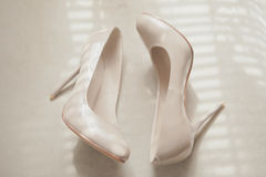 Beige wedding patent leather shoes. On light background Royalty Free Stock Photos