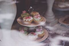 Beige White Cupcake on 2 Layer Stand Near White Baluster Royalty Free Stock Photos