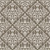 Seamless vintage floral wallpaper pattern. Beige and white seamless floral wallpaper pattern vector template. Seamless wrapping paper, textile or upholstery Royalty Free Stock Image