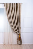 Beige window curtain in the bathroom Royalty Free Stock Image