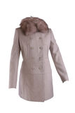 Beige winter coat. With fur collar isolated on white Royalty Free Stock Photography