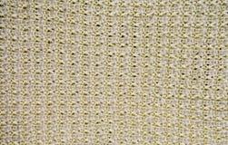 Beige Wollmaschenware mit Musternahaufnahme Stockbilder