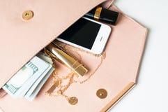 Beige woman's clutch handbag Stock Image