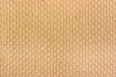 Beige wool knitted texture closeup. Natural wool fabric background Stock Photos
