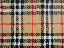 Beige wool plaid fabric with red, black and white stripes Royalty Free Stock Photos