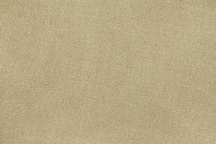Beige woolen plane fabric with without waves. Background smooth tissue stock image