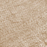 Beige woven texture as background. In Sepia toned. Retro style Stock Images
