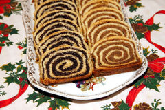 Beigli is the famous hungarian christmas cake. Some pieces of traditional hungarian cake poppy rolls beigli on a porcelain plate stock photos
