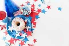 Beignet avec du jus et des sucreries le Jour de la Déclaration d'Indépendance Image libre de droits