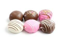 Beignet coloré de chocolat Photos stock