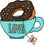 Beignet de tasse de thé d'amour et de gâteau de chocolat Images stock