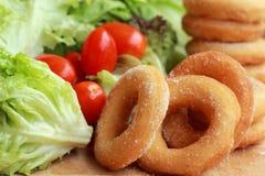 Beignet et sucre - salade de légume frais. Images libres de droits