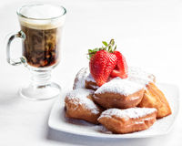 Beignets and Coffee. A plate of homemade beignets and coffee with milk Stock Images