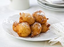 Beignets covered with powdered sugar. Royalty Free Stock Photography