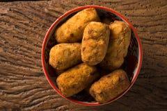 Beignets de morue, tapas espagnols traditionnels Bunuelos de Bacalao Photo stock