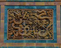 Beihai Park glazed brick groups. Two cloud dragons, a fire bead. `In the` dragon `michimasa in jaw`, the dragon is considered to be a pearl, can avoid the fire royalty free stock image