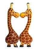 Beijando o girafa de madeira na forma do amor Imagem de Stock