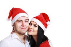 Beijando pares no Natal Fotografia de Stock Royalty Free