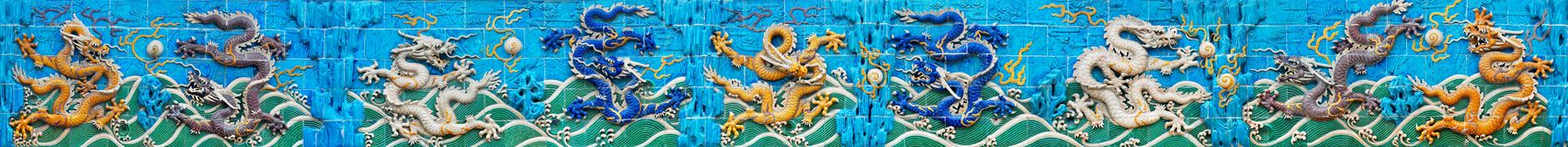 Beijing. Nine-Dragon Wall. It was built in 1756 and is one of three walls of its kind in China. It is made of glaze bricks of seven-colors. Nine complete Stock Image