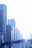 Beijing. Perspective of avenue in haze toned in blue color, Beijing, China Royalty Free Stock Images