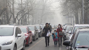 Beijing authorities boost the second smog alert red level Royalty Free Stock Photo