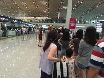 Beijing Capital International Airport. People are queuing in a long line for Checking in the flight royalty free stock image