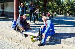 BEIJING, CHINA – October 15, 2013: men playing checkers Xiangqi - the Chinese national board game. BEIJING, CHINA – October 15, 2013: Elderly men royalty free stock images