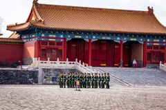 Changing of the guard at Forbidden City, soldiers marching in a formation stock image