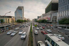 BEIJING, CHINA - CIRCA JUNE 2015, the view on the road highly loaded with traffic. Leading to Beijing's financial center Gumao on a sunny day in Beijing China Royalty Free Stock Photos