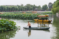 Beijing, China - circa September 2015: People sailing boats in the moat around Forbidden Palace, Beijing,  China Stock Photo