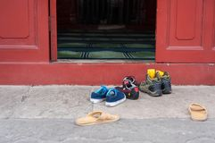 Removed footwear outside the main prayer hall at the Cow Street Mosque, Beijing, China. BEIJING, CHINA - DEC 27, 2013 - Removed footwear outside the main prayer royalty free stock photography