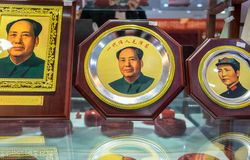 Portraits of Chairman Mao Zedong for sale at gift store at Qianmen street in Beijing city. royalty free stock photography
