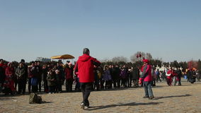 Beijing, China-Feb 2, 2014: Lots of people watch the old man and woman play diabolo together at temple fair. During Chinese Spring Festival in Beijing, China