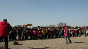 Beijing,China-Feb 2, 2014: Lots of people watch the old man and woman play diabolo together at temple fair. During Chinese Spring Festival in Beijing, China2