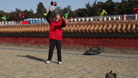 Beijing,China-Feb 2, 2014: The old man plays diabolo at temple fair during Chinese Spring Festival in Beijing,. China