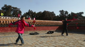 Beijing,China-Feb 2, 2014: The old man and woman play diabolo together at temple fair during Chinese Spring Festival in Beijing,. China