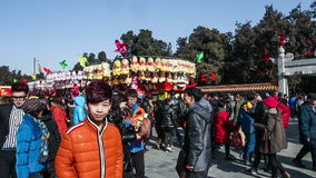 Beijing,China-Feb 2, 2014: People go pass by toys stands at temple fair during Chinese Spring Festival in Beijing, China. Beijing,China-Feb 2, 2014: People go