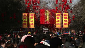 Beijing,China-Feb 2, 2014: People holding toys in Ditan Park during Chinese Spring Festival in Beijing,. China