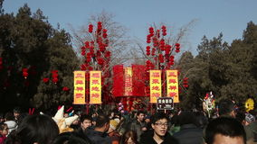 Beijing,China-Feb 2, 2014: People take photos under the red lanterns in Ditan Park during Chinese Spring Festival in Beijing,. China
