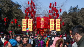 Beijing, China-Feb 2, 2014: People take photos under the red lanterns in Ditan Park during Chinese Spring Festival in Beijing,. China