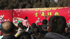 Beijing,China-Feb 2, 2014: Visitors stand still for watching clown show at temple fair during Chinese Spring Festival in Beijing,. China