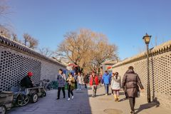 Unacquainted Chinese people or tourist walking in Nanlouguxiang the Old Part area of the Beijing city centre stock image