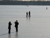 Beijing, China. Iced over lake Beijing, China locals walking  on to the ice for pictures Stock Photos