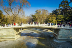 BEIJING, CHINA - 29 JANUARY, 2017: Beautiful suspense bridge crossing ricer inside spring palace complex, a spectacular Royalty Free Stock Photos