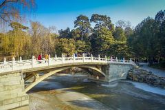 BEIJING, CHINA - 29 JANUARY, 2017: Beautiful suspense bridge crossing ricer inside spring palace complex, a spectacular Stock Image