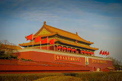 BEIJING, CHINA - 29 JANUARY, 2017: Beautiful temple building inside forbidden city, typical ancient Chinese architecture. Picture of Mao hanging on facade Stock Photos