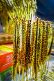 BEIJING, CHINA - 29 JANUARY, 2017: Centipedes ready to eat hanging on sticks, local chinese food market concept Stock Photography