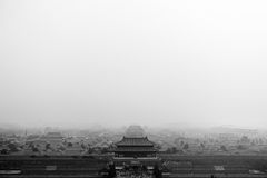 BEIJING, CHINA - 29 JANUARY, 2017: Foggy spectacular overview of the forbidden city, captures a beautiful morning mood. In black and white Royalty Free Stock Photos