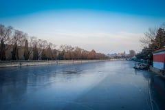 BEIJING, CHINA - 29 JANUARY, 2017: Frozen water channel inside forbidden city, trees alongside river bank, beautiful Stock Photos